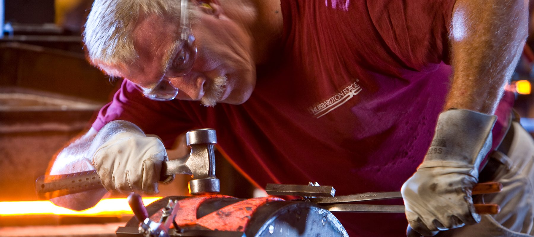 blacksmith working on handcrafting Hubbardton Forge lighting